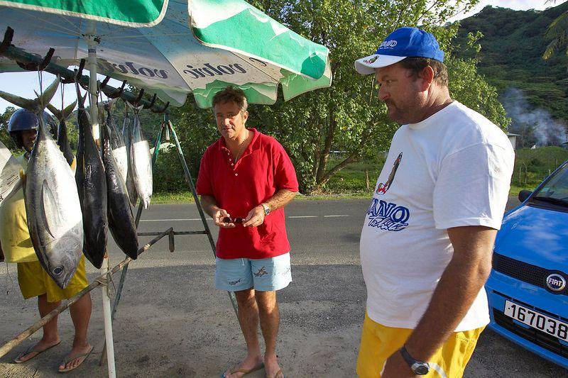 Douglas buys some fish (Moorea - Misc Topside)