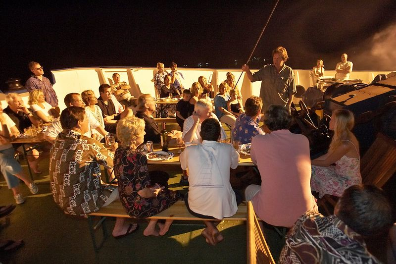 Mike McDowell gives a speech during the final barbecue celebration on the bow of the Shokalskiy (Boat - Akademik Shokalskiy)