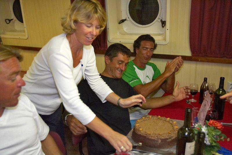 Belinda Sawyer presents Pierre Tricottet with a birthday cake (Boat - Akademik Shokalskiy)