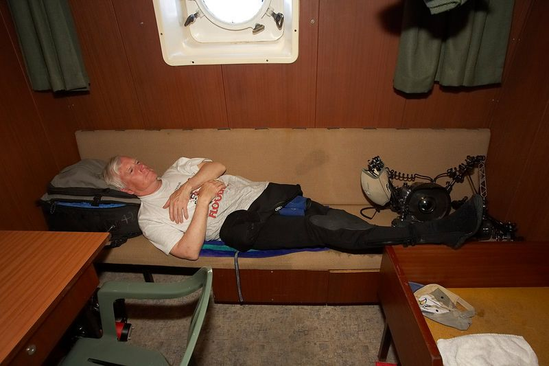 Ken Howard naps in the camera room (Boat - Akademik Shokalskiy)