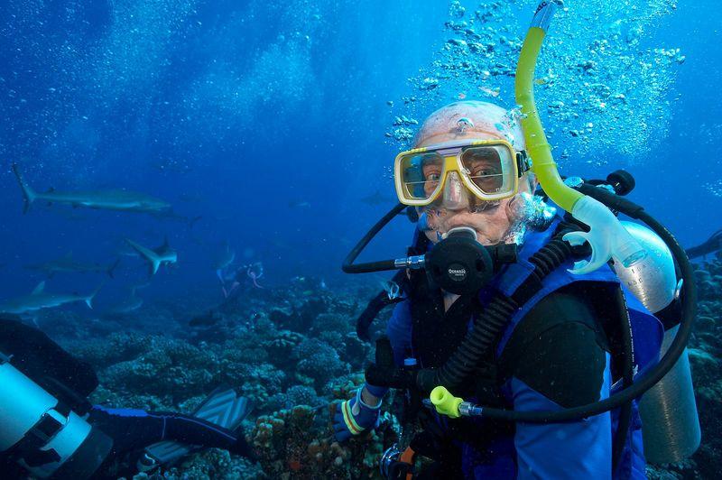 Ed Callan with grey reef sharks (Fakarava - South Pass)