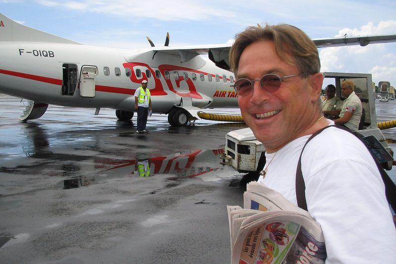 Lucien prepares to board an Air Tahiti flight to Fakarava