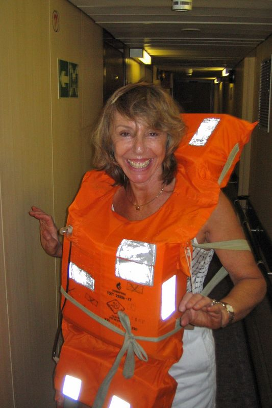 Marti dons her lifevest for the emergency drill.