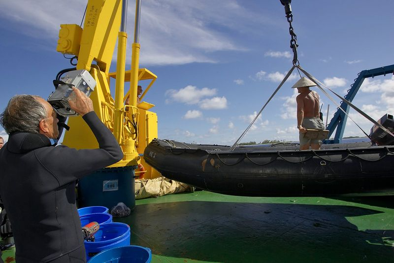 Ron Taylor films Costa being lifted up on the zodiac (Boat - Akademik Shokalskiy)