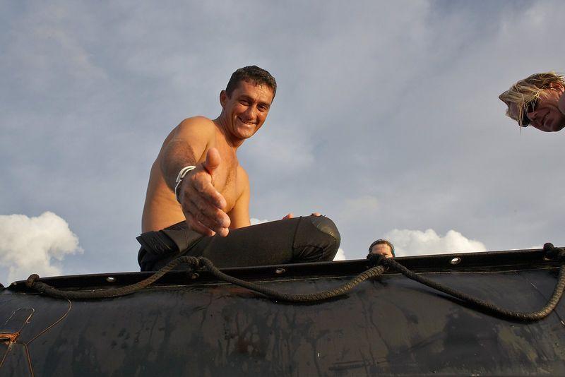 Pierre Tricottet gives me a hand onto the zodiac (Tikehau - Shark Hole)