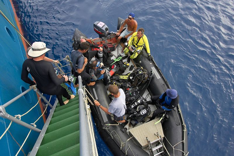 Loading up the zodiac for a dive: Douglas Seifert, Remy, Ken Howard, Steve Algar, Guy de la Valdene, Mike McDowell, Pierre Tricottet (Boat - Akademik Shokalskiy)