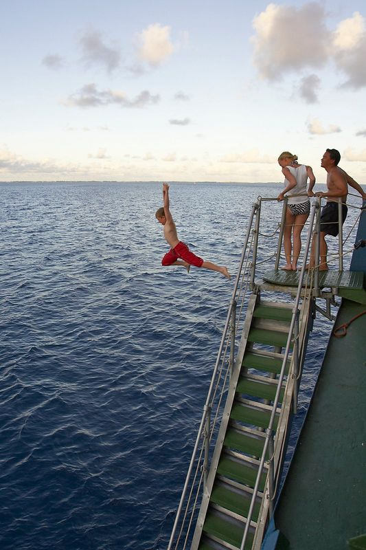 Timoty McDowell, Krissy Gossman, and Eric Cheng jumping off of the gangway (Boat - Akademik Shokalskiy)