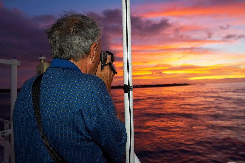 Ron Taylor takes footage of sunset (Boat - Akademik Shokalskiy)