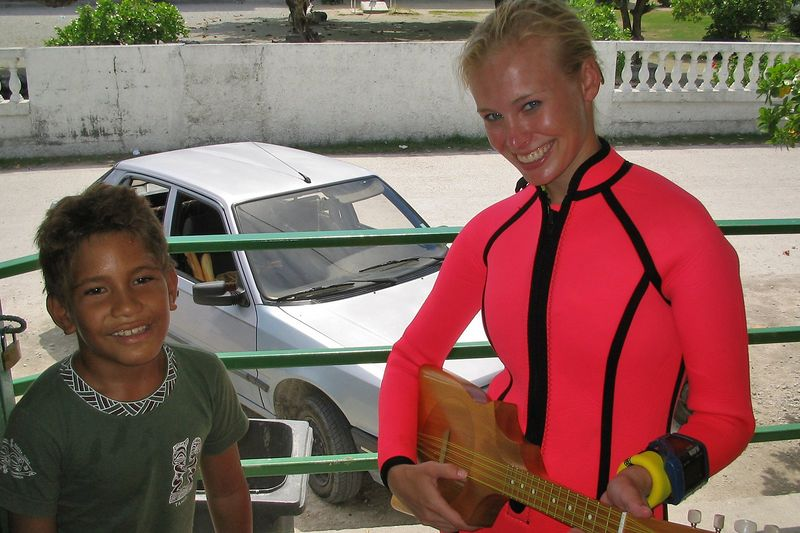 Kristina Gossman hangs out with a local kid (Rangiroa - Misc Topside)