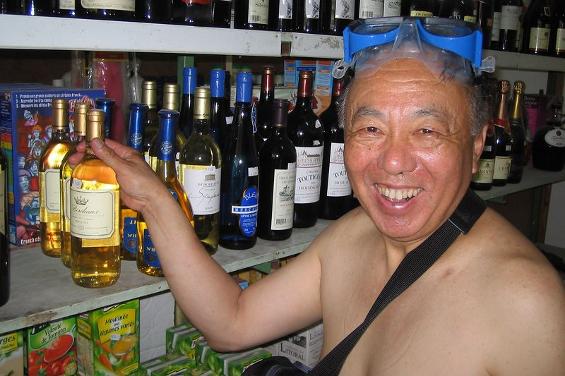 Jerry Watanabe, dressed to please in the wine section (Rangiroa - Misc Topside)
