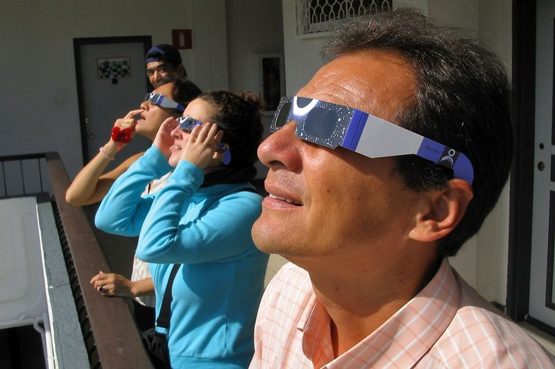 John and the e-Tahiti Travel staff wear eclipse glasses to see the eclipse