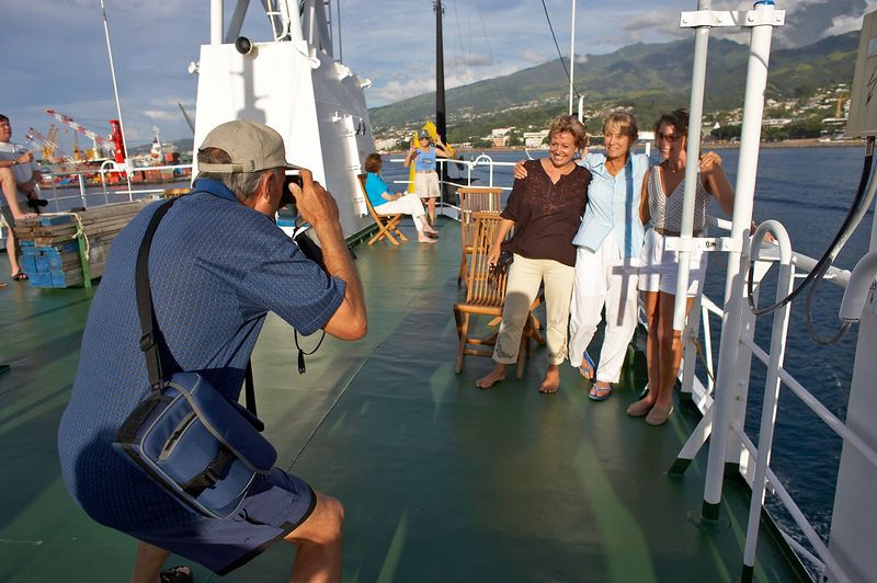 Ron Taylor photographs Jenny Cornish, Valerie Taylor, and Marti Georgeff on the top of the Shokalskiy, Tahiti