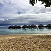 Beach view of the overwater bungalows at the Hilton Mo'orea