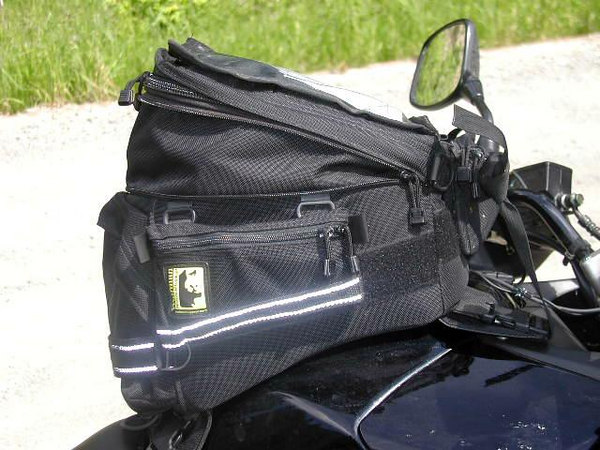 The Wolfman Explorer tank bag....the Swiss Army knife of tankbags....tough, roomy, and very well made.....and it doesn't move around unless you want it to....easy to get to the gas filler also.  A bargain!!