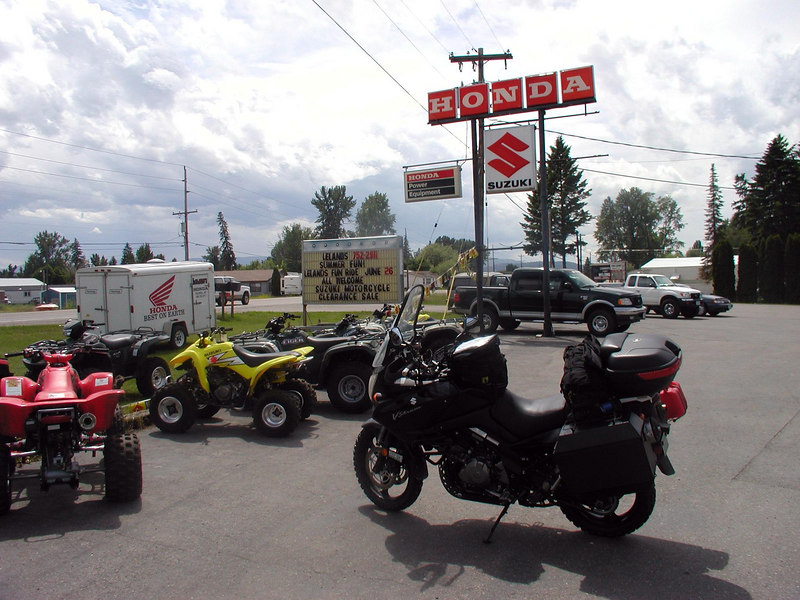 "After almost not getting a room in Bozeman, and leaving my rain gear at the diner, got up the next morning, went to the sporting goods store and bought more rain gear. Lost my gloves also, and couldn't find replacements I liked, so settled for some deerskin ropers. Headed up  a series of backroads until I wound up on SH 83, known as ""The Swan"". and rode it into Kalispell and Lelands Suzuki....GREAT FOLKS!!! Saturday morning, they fitted the Conti TKC-80s' that I had ordered from them a month or so earlier....semi-knobbies, and if I hadn't had them, I'd probably still be somewhere in the mountains today.....great tires, recommended by Pat Moriarity...excellent advice..."