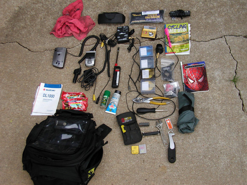 The tankbag contents....found out why most folks wear gloves.....I don't likem', but they do prevent sunburn on the backs of your hands....but then so does sunscreen...little square jobbies up the middle is part of my mini disk collection....got to revisit a lot of my favorite music, uninterupted....the Spider Man notebook is what I used for my trip journal, which my wife insisted I keep...I'm glad she did!...little gold item above the mini disks is the player...didn't even use 1 battery for the whole trip, just outstanding.<br /> <br /> Hope you enjoyed this, I sure did<br /> <br /> Phil Porter
