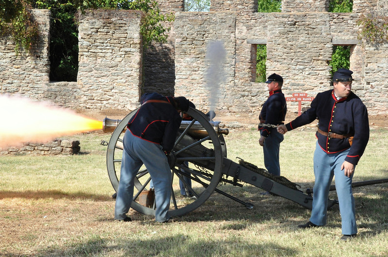 Fort Sill six pound cannon gun crew firing one off.