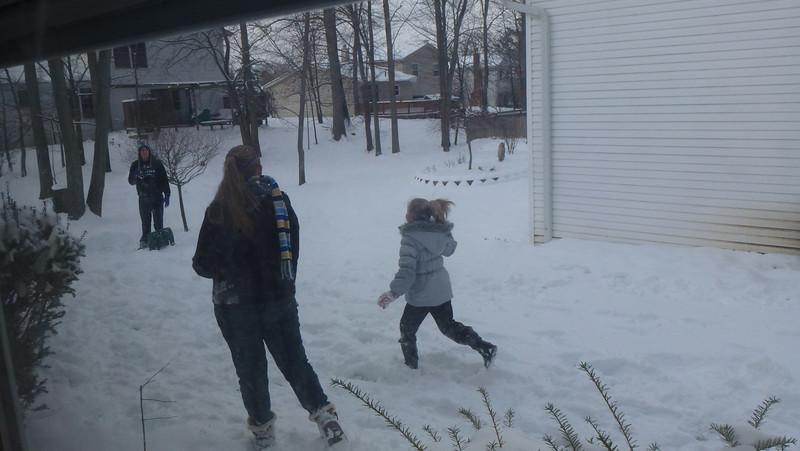 Tori and Lauren throwing snowballs at Jake.