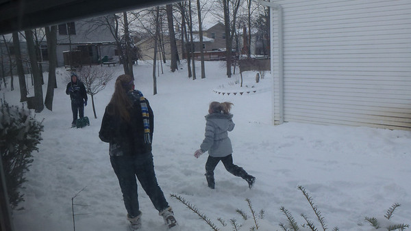 Tori and Lauren throwing snowballs at Jake.