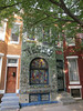 A row house near Druid Hill Park covered in broken-glass mosaic by artist Loring Cornish.