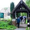 North Stoneham: St Nicholas Church: Group walking through lychgate