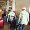 Heathrow: Terminal 5: Group gathering luggage