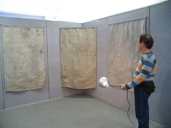 Visitors could interactively see the images by using the hand held lights.