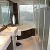 The master bathroom of an A6 forward courtyard villa with dramatic views, elegant tub and shower overlooking the sea.<br /> The A3 Courtyard Villas have port and starboard views.