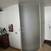 Sliding frosted glass panel door to accessible cabin