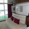 The curved wall and sofa in a New Wave stateroom.