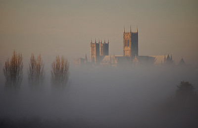 Lincoln Cathedral floats above the mist, viewed from the road between Canwick and Heighington