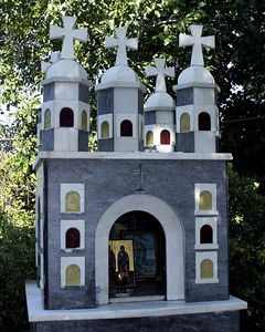 Iconostasi -- A small roadside shrine put up to honor or remember someone.