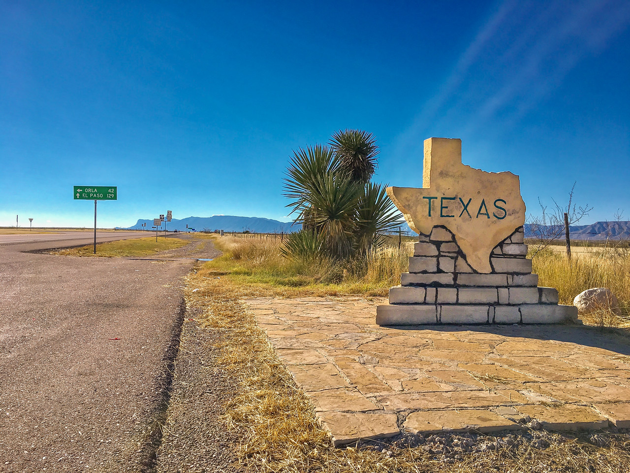TEXAS-NEW MEXICO STATE LINE WITH THE GUADALUPE MOUNTAINS SEEN IN THE BACKGROUND