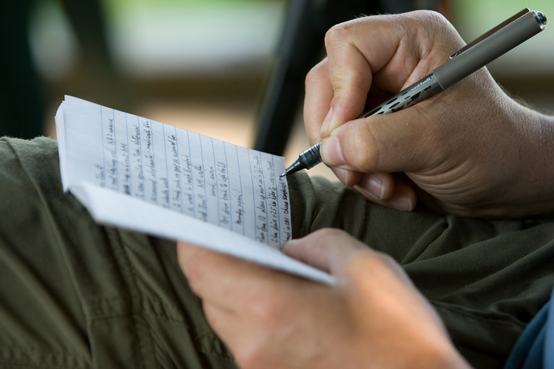 Bill catching up on travel journal writing at Langoue Bai.