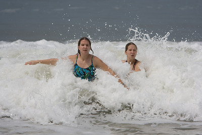 Abby and Gennie getting attacked by a wave.