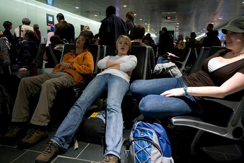 Waiting at Logan Airport, Theo sleeping.