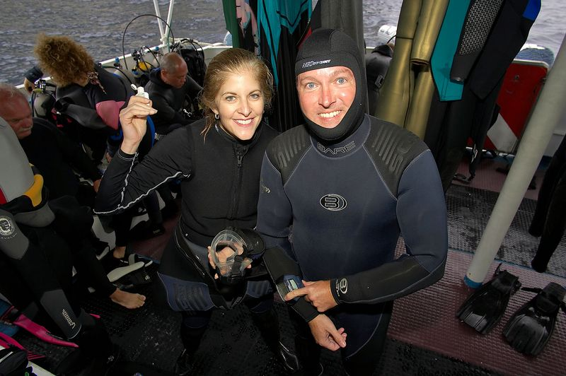 Carol and Doug Ebersole suit up for a dive (Galapagos - Deep Blue)