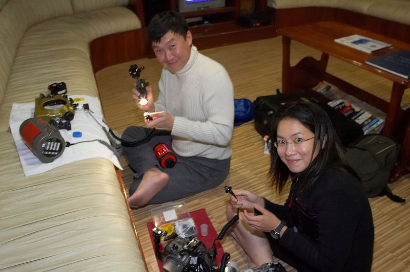 Paul and Lena assemble camera gear (Galapagos - Deep Blue)
