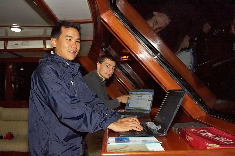 Eric Cheng and Emile Litvak pick up a stray wireless signal from San Cristobal (Galapagos - Deep Blue)