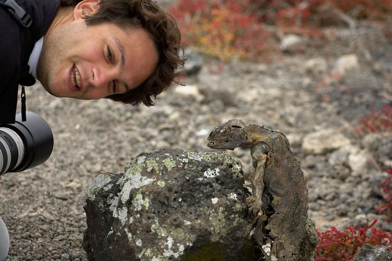 Alexis Tabah with a dead land iguana (Conolophus subcristatus) (Galapagos - South Plazas)