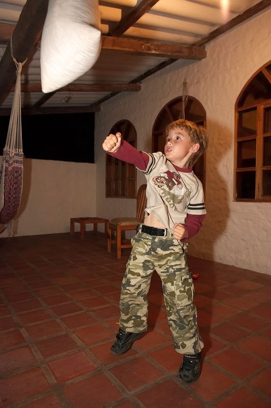 Paul Stewart's son, punching a bag (Galapagos - Santa Cruz)