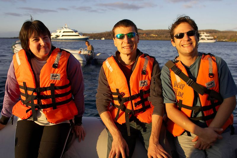 Heather, Emile, and Alexis on a panga to shore (Galapagos - Deep Blue)
