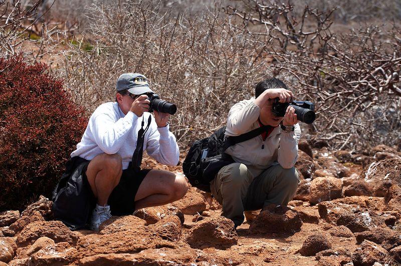 Doug and Paul photograph local animals (Galapagos - North Seymour)