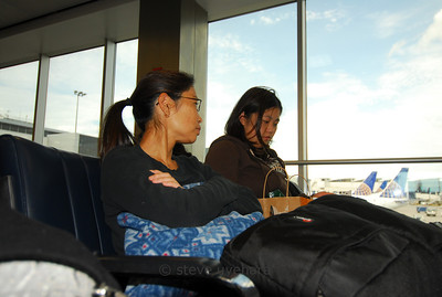 Gayle and Rachel wait to board the flight to Quito