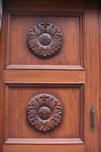 Door carving in Quito.