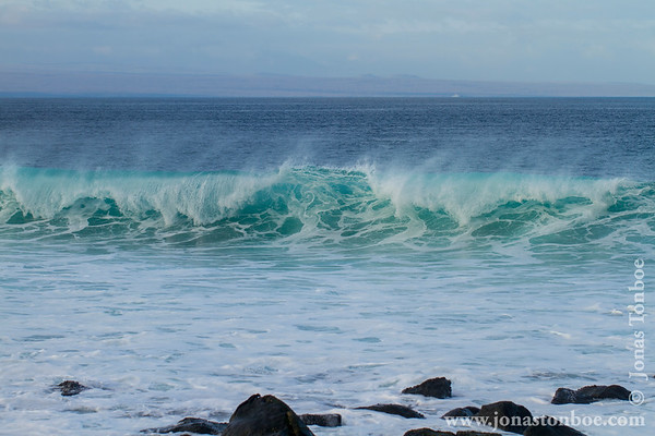 Ecuador. Galapagos Islands. North Seymour island: Breaking waves