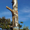 "A ""totem pole"" at the Equator museum displaying birds and animals of Ecuador"