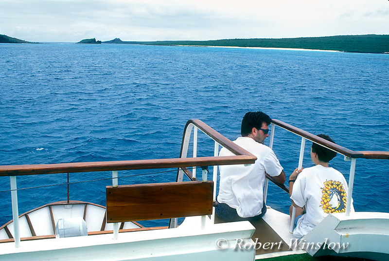 Model Released, Young Man and Woman Relaxing on Tour Boat, Espanola Island, Galapagos Islands, Ecuador