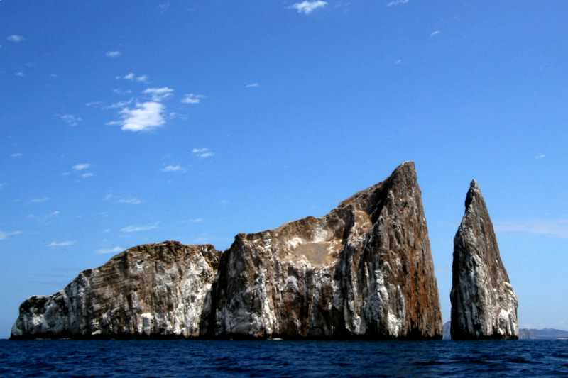 Monday, January 09, 2006<br /> <br /> Our island exploration continued today with a boat tour around San Cristobal.  The first stop we made was at Kicker Rock, a mammoth rock protruding from the water and extending approximately 330 feet in the air.  A split between the rocks is a popular snorkeling site with views of numerous Hammerhead Sharks circling below.<br /> <br /> Angela Vitale