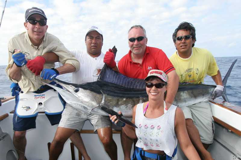 "Saturday, January 07, 2006<br /> <br /> This photogenic Marlin was caught  by Dr. Julie Ball. Holding the fish left to right are Andy LoCasio, Gustavo the boats owner, Pete Santini, and ""Berto"" one of the most experienced mates in the South Pacific."